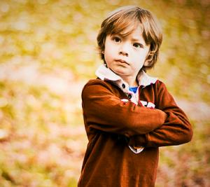 boy folding his arms
