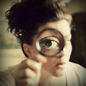 eye in magnifying glass