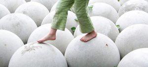 child walking on round spheres