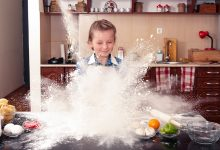 Little girl cooking in the kitchen and making a very big mess
