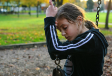 Young girl sitting on a swing: 3 things to do after you've lost your temper with your kids