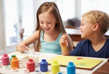 Little boy and girl painting pictures