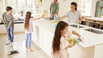 Family cleaning the kitchen together