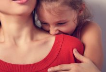 Child biting her mother's shoulder