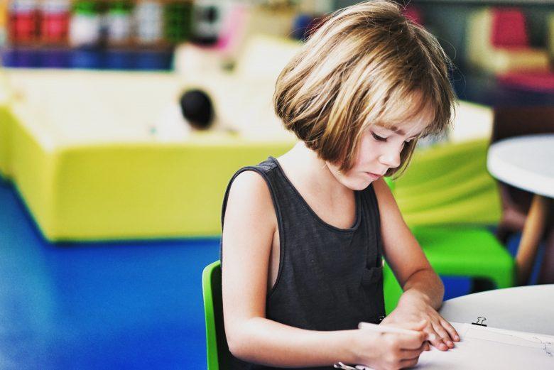 child sitting at desk