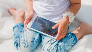 Child playing on a mobile device