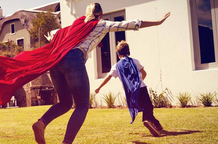 boy running with a superhero cape