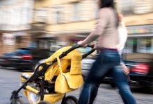 Mother pushing a stroller around with the world going around quickly