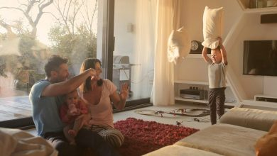 Mom, Dad, and child having a pillow fight