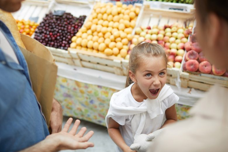 A child acting up in a grocery store.