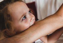 Child biting someone else's arm