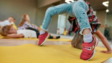 Child doing a backbend on a yoga mat