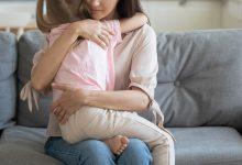 Little girl and mom hugging